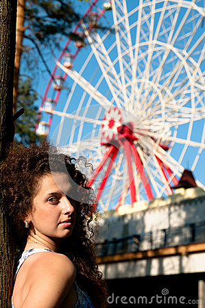 Girl On The Background Of Entertainment Attraction Stock Photo - Image: 25325550