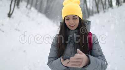 Girl with Backpack Using Smartphone Gps. Compass in forest stock footage
