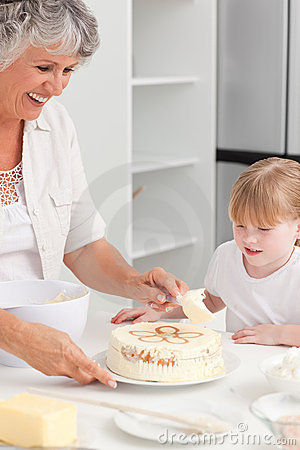 Girl baking with her grandmother