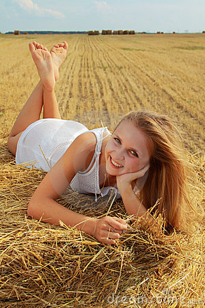 Girl on a bale