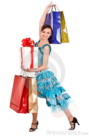 Girl in ball dance dress with gift box, shop bag.