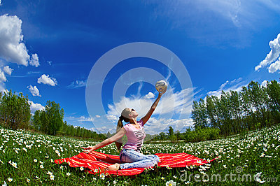 Girl with a ball of white flowers