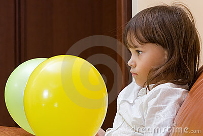 The girl with balloons.