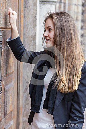 Girl bangs in a closed door