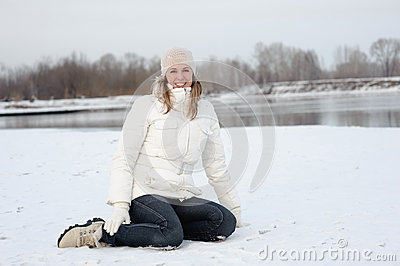 The girl on the bank of the river in winter