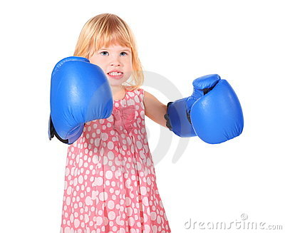 Girl with bared teeth and boxers gloves