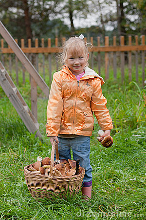 Girl with a basket of ceps