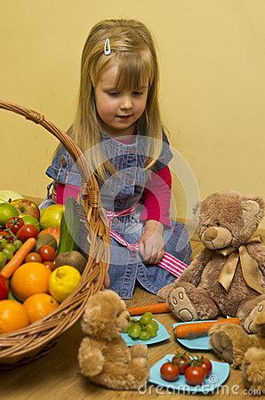 Girl with basket of fruit and vegetables