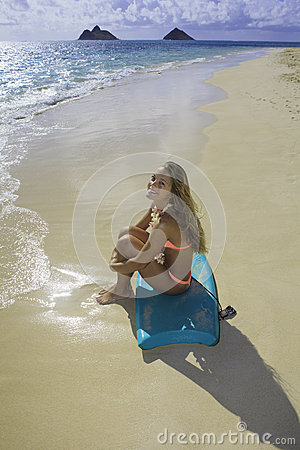Girl on the beach with boogie board