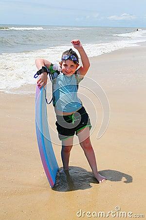 Girl on the Beach Boogie Boarding