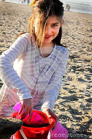 Girl at Beach with Sand Toys