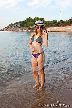 Girl at Beach with Starfish