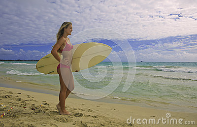 Girl at beach with surfboard