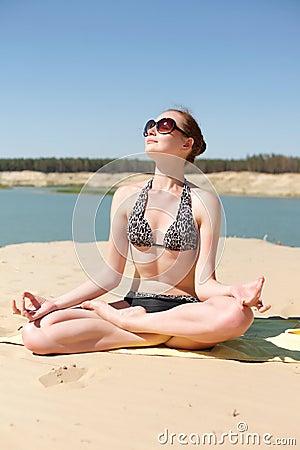 Girl on the beach yoga
