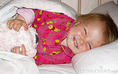 Girl with a bear is going to sleep