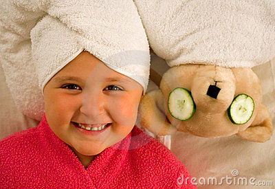 Girl and bear in towels
