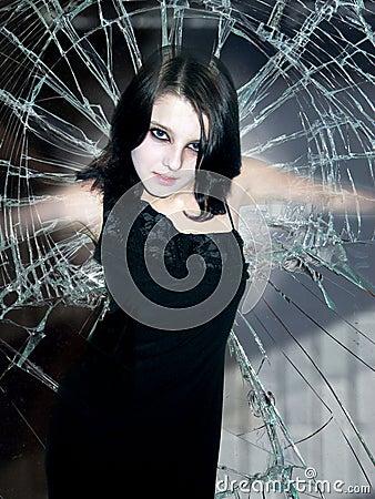 Girl in beaten glass