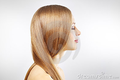 Girl with beautiful straight hair on gray