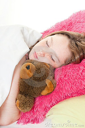Girl in bed with stuffed bear