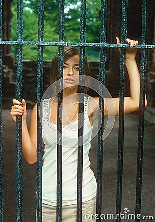 Sexy teen behind bars stock photo image 33956980