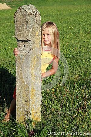 Girl behind the stone bollard