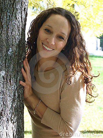 Girl behind the tree