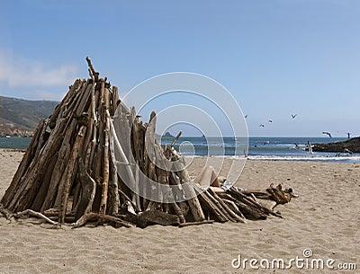 Girl behind wind breaker on the beach