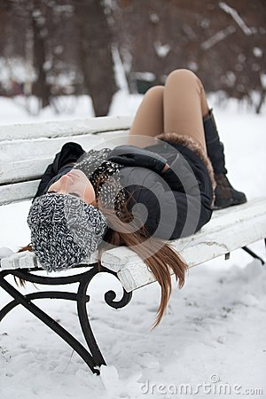 Girl on a bench in the winter