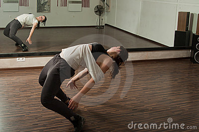 Girl bending in front of a mirror