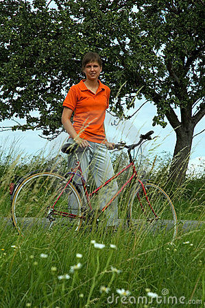 Girl with bicycle in country