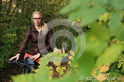 Girl on bicycle in forest