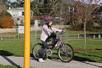 Girl on bicycle at park