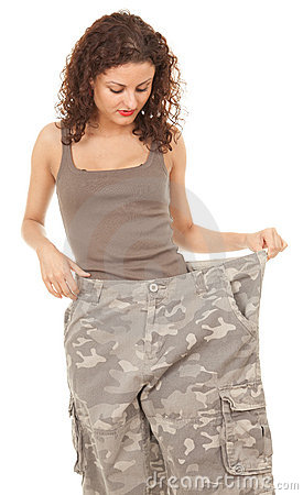 Girl into big camouflage trousers