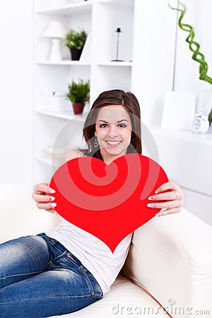 Girl with big red heart in hand