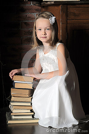 Girl with a big stack of books