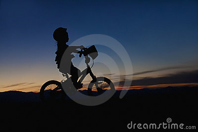 Girl on a Bike at Sunset