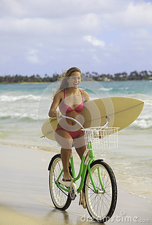 Girl with bike and surfboard