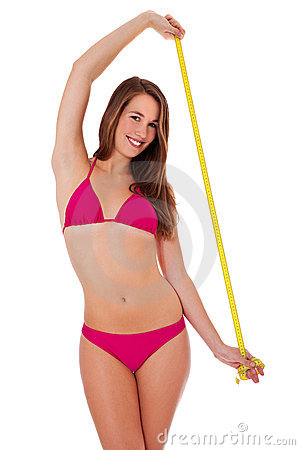 Girl in bikini with measuring tape