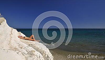 Girl in bikini sunbathing