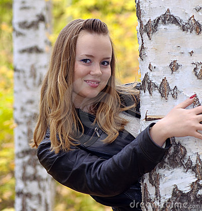 Girl at a birch forest