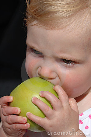 Girl biting apple