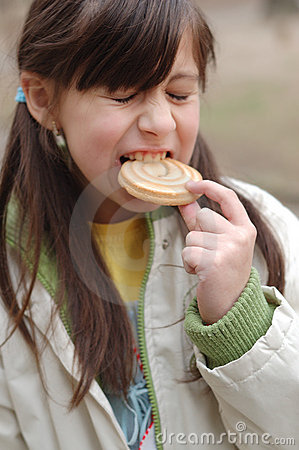 Girl biting into cookie