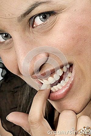Girl biting her nail