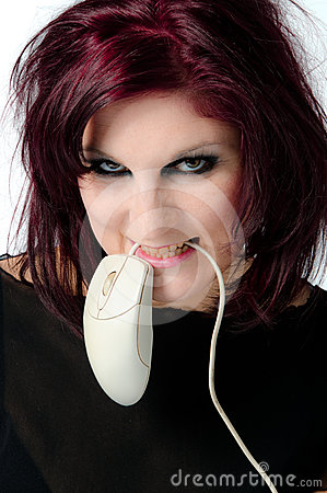 Girl biting a mouse cord