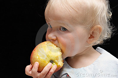 Girl bitting apple