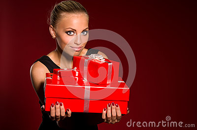 Girl in a black dress with gifts in hands