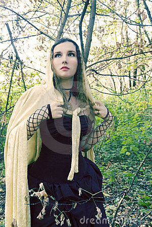 Girl in a black dress and gold cloak