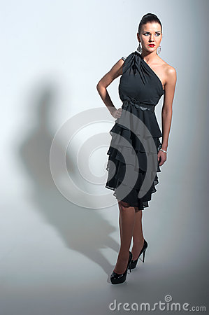 Girl in black dress posing