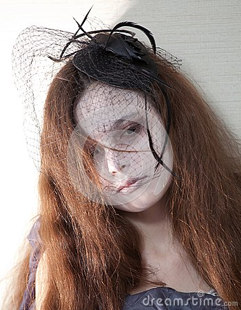 Girl with black lace over face
