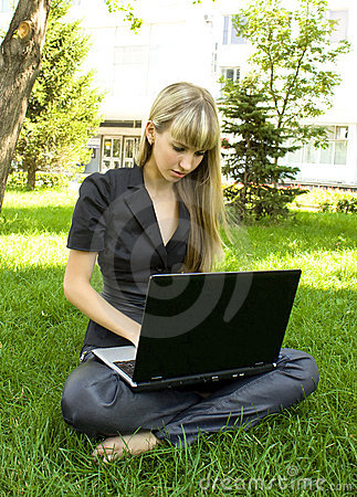 The girl in black, on the lawn with a laptop